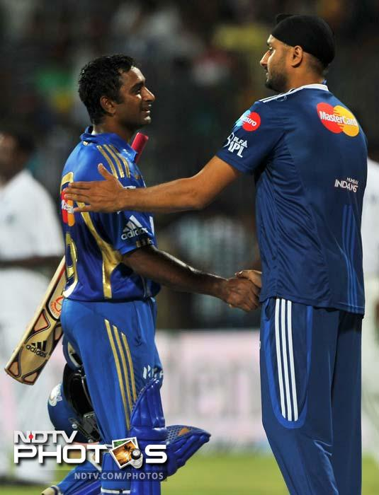 Mumbai Indians captain Harbhajan Singh congratulates his team-mate Ambati Rayudu after their team's victory in first the IPL Twenty20 cricket match against Chennai Super Kings in Chennai. Mumbai Indians chased down a score of 113 with eight wickets in hand. (AFP PHOTO/Manjunath KIRAN)