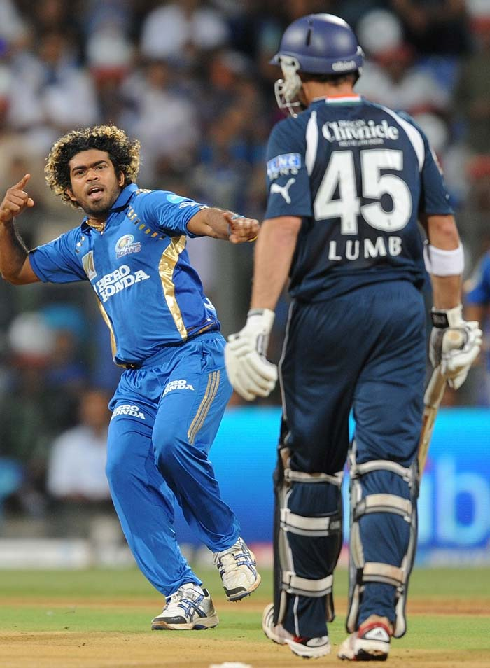 Mumbai Indians bowler Lasith Malinga (L) celebrates the wicket of Deccan Chargers batsman Michael Lumb (R) during the IPL Twenty20 cricket match at the Wankhede Cricket stadium in Mumbai. (AFP PHOTO)