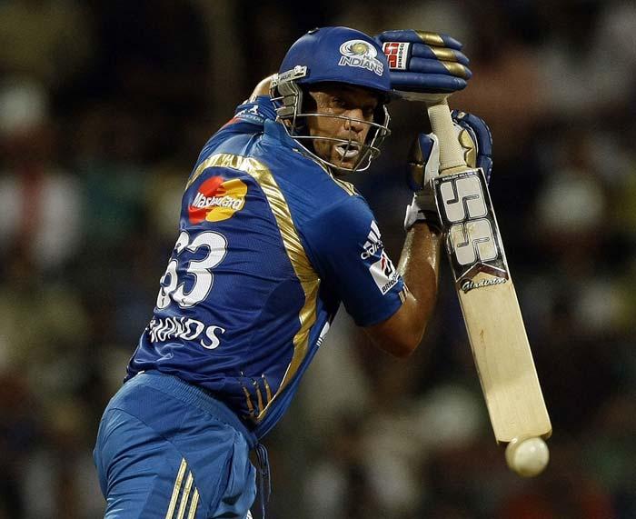 Mumbai Indians batsman Andrew Symonds plays a shot during the IPL Twenty20 match against Deccan Chargers at the Wankhede Cricket stadium in Mumbai. (AP PHOTO)