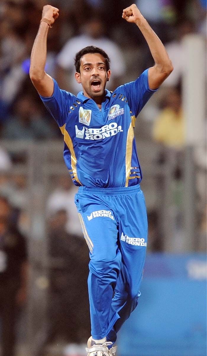 Mumbai Indians bowler Dhawal Kulkarni celebrates after taking wicket of Deccan Chargers batsman Daniel Christian during the IPL Twenty20 cricket match at the Wankhede Cricket stadium in Mumbai. (AFP PHOTO)