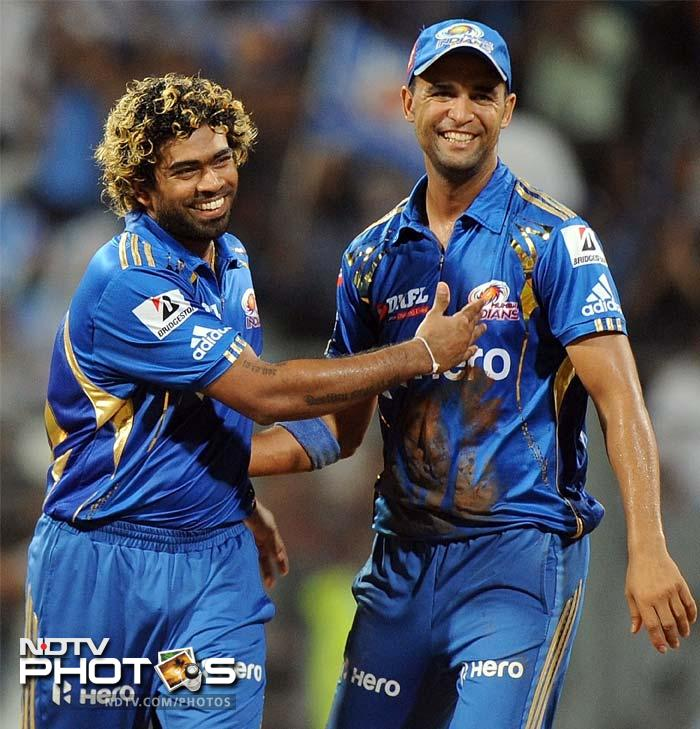 Lasith Malinga also got the key wicket of Deccan skipper Cameron White who led the Hyderabad based side as regular captain Kumar Sangakkara sat out the game due to poor form. (AFP PHOTO/Punit PARANJPE)