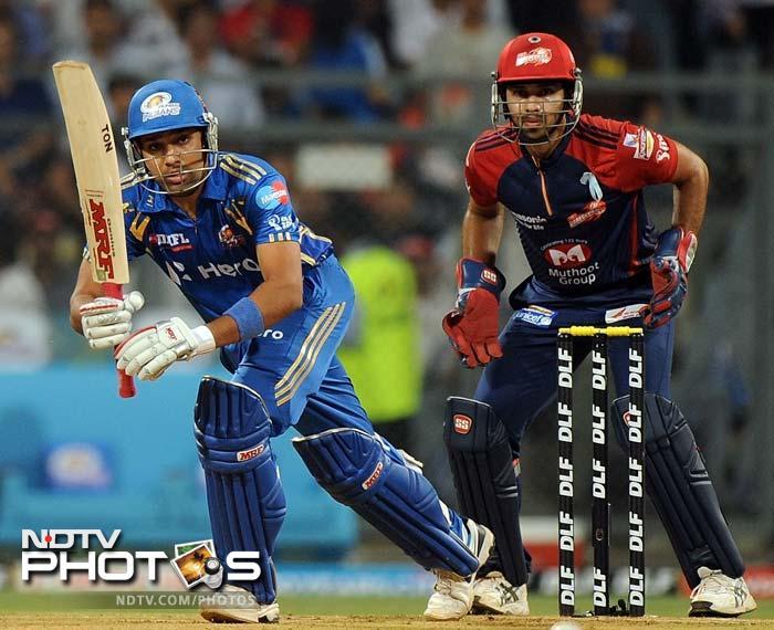 Mumbai Indians batsman Rohit Sharma (L) plays a shot during the IPL Twenty20 cricket match against Delhi Daredevils at the Wankhede Stadium in Mumbai. (AFP PHOTO/Punit PARANJPE)