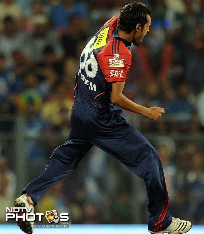 Delhi Daredevils bowler Shahbaz Nadeem celebrates after taking the wicket of Mumbai Indians batsman Davy Jacobs during the IPL Twenty20 cricket match at the Wankhede Stadium in Mumbai. (AFP PHOTO/Punit PARANJPE)
