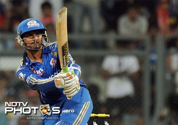 Mumbai Indians captain Harbhajan Singh plays a shot during the IPL Twenty20 cricket match against Delhi Daredevils at the Wankhede Stadium in Mumbai. (AFP PHOTO/Punit PARANJPE)