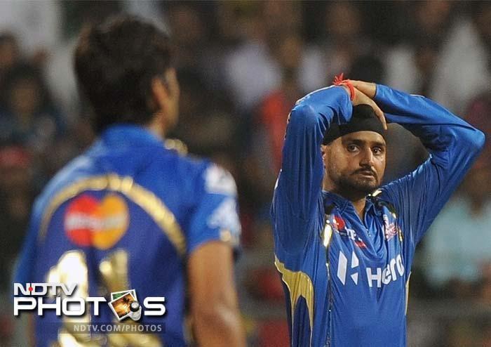 Mumbai Indians captain Harbhajan Singh (R) reacts during the IPL Twenty20 cricket match against Delhi Daredevils at the Wankhede Stadium in Mumbai. (AFP PHOTO/Punit PARANJPE)