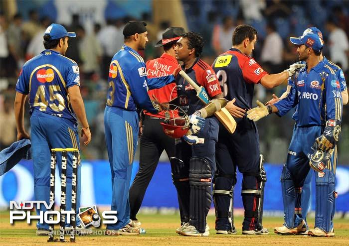 Chasing 93, Delhi Daredevils cruised to a win in 14.5 overs to beat Mumbai Indians by 7 wickets at the Wankhede Stadium in Mumbai. With the win, Delhi climbed to the top of the points table. (AFP PHOTO/ PUNIT PARANJPE)