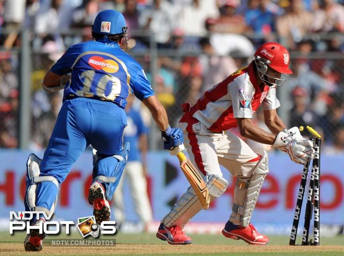 Sachin Tendulkar was run out by Kings XI Punjab's David Miller while trying to steal a second on the first ball of the ninth over. (AFP PHOTO/Indranil MUKHERJEE)