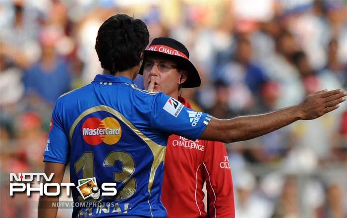 Mumbai Indians bowler Munaf Patel was cautioned by umpire Rod Tucker after a verbal spat with Kings XI Punjab batsman Mandeep Singh during the match. (AFP PHOTO/Indranil MUKHERJEE)