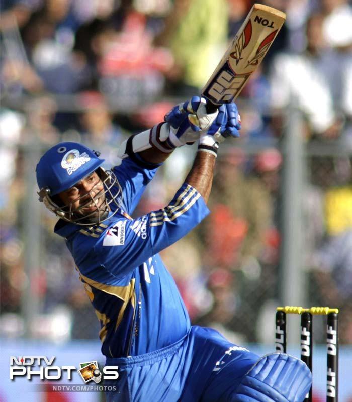 Dinesh Karthik started the acceleration for Mumbai, hitting five boundaries, before departing for 35 off 20 balls. (AP Photo/ Rajanish Kakade)