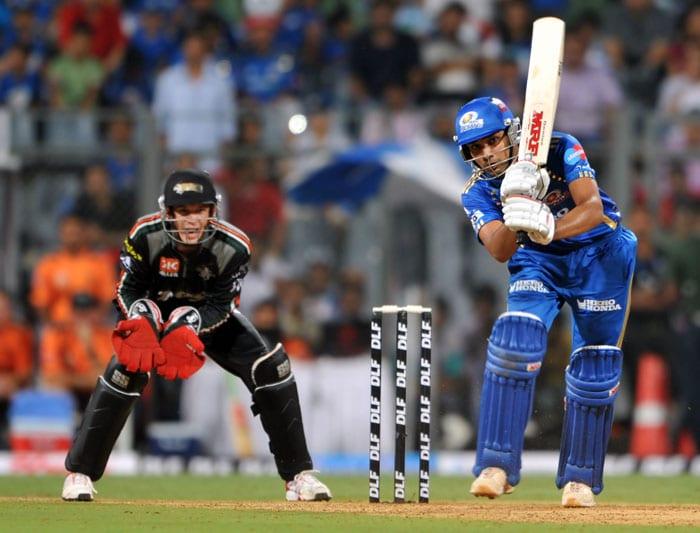 Mumbai Indians batsman Rohit Sharma (R) plays a shot as Pune Warriors wicketkeeper Tim Paine eyes the ball during the IPL Twenty20 cricket match at the Wankhede stadium in Mumbai. (AFP PHOTO)