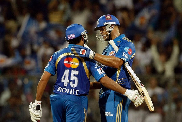 Mumbai Indians' Andrew Symonds, right, celebrates with Rohit Sharma after they won the Indian Premier League (IPL) cricket match against Pune Warriors in Mumbai. (AP Photo)