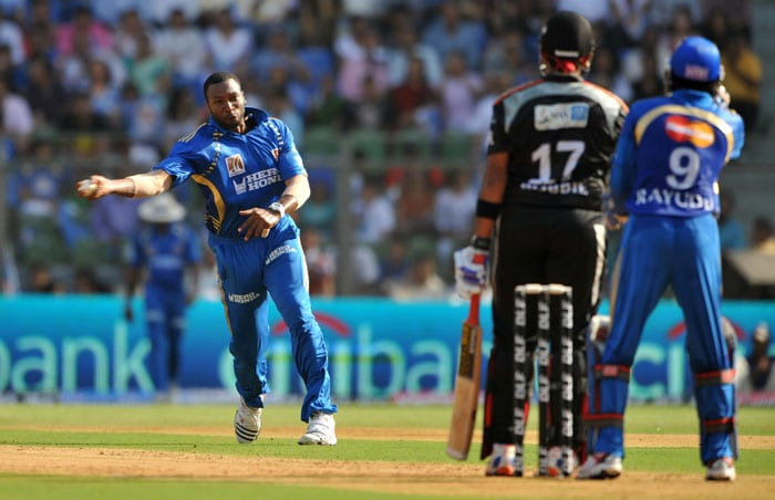 Mumbai Indians bowler Kieron Pollard (L) reacts during the IPL Twenty20 match against Pune Warriors at the Wankhede stadium in Mumbai. (AFP PHOTO)