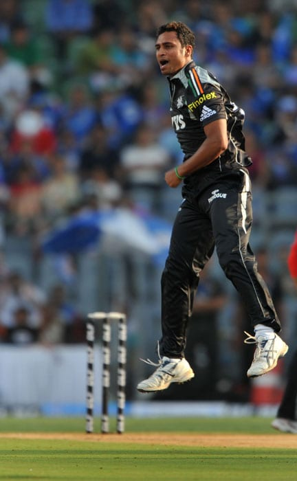 Pune Warriors bowler Shrikant Wagh celebrates the dismissal of Mumbai Indians batsman James Franklin during the IPL Twenty20 match at the Wankhede stadium in Mumbai. (AFP PHOTO)