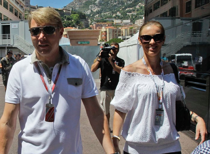 Former double world champion Finnish driver Mika Hakkinen arrives in the paddock with an unidentified partner, prior to the start of the Monaco Formula One Grand Prix at the Circuit de Monaco in Monte Carlo. (AP PHOTO)