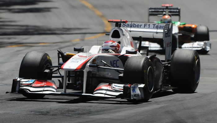 Sauber's Japanese driver Kamui Kobayashi (L) and Force India's German driver Adrian Sutil drive at the Circuit de Monaco in Monte Carlo during the Monaco Formula One Grand Prix. (AFP PHOTO)