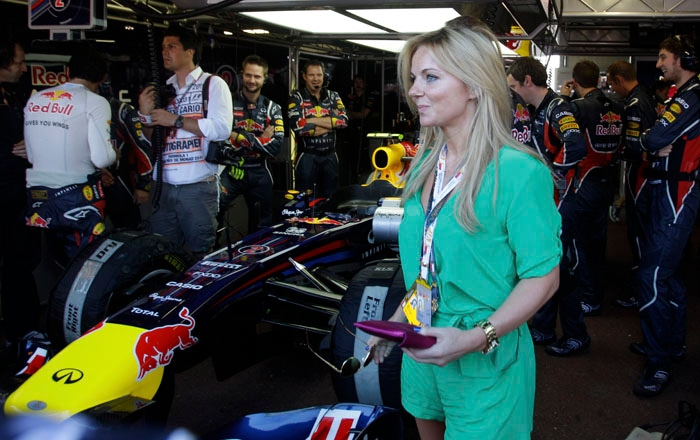 British pop-singer Geri Halliwell looks on in the Red Bull pit prior to the start of the Monaco Formula One Grand Prix at the Circuit de Monaco in Monte Carlo. (AP PHOTO)