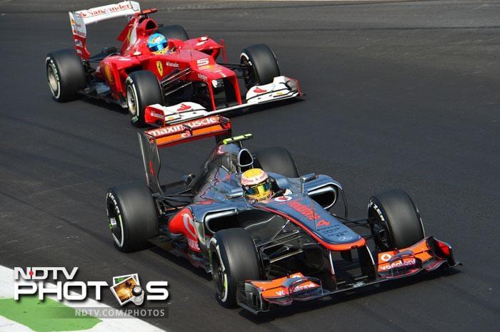 McLaren Mercedes' British driver Lewis Hamilton overtakes Ferrari's Spanish driver Fernando Alonso during the qualifying session at the Autodromo Nazionale circuit.