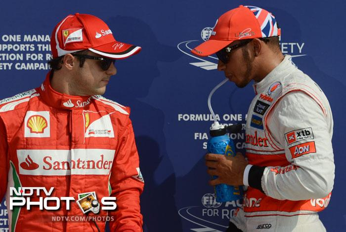 British driver Lewis Hamilton and Ferrari's Brazilian driver Felipe Massa arrive in the parc ferme at the Autodromo Nazionale circuit