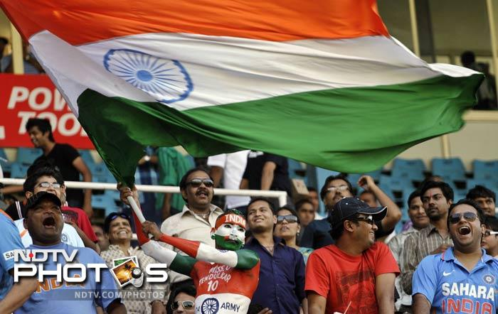 The colourful home fans erupted in joy as the Indian bowlers struck with a few quick wickets
