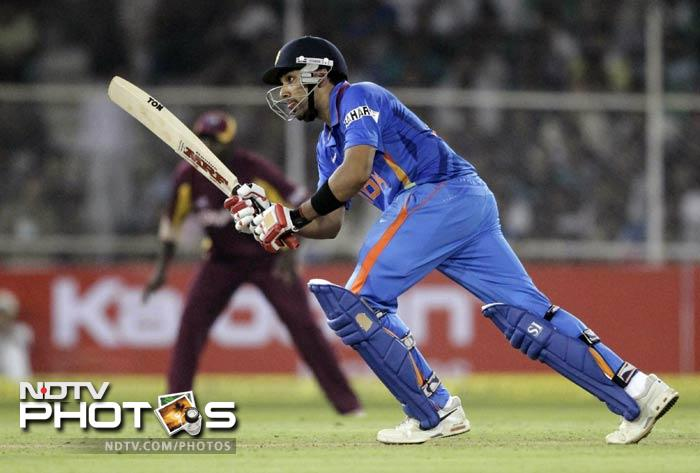Sharma hit 10 boundaries and a six but was eventually run-out by Darren Sammy. Abhimanyu Mithun slapped two sixes and two boundaries but West Indies finally prevailed to stay alive in the 5-match series.