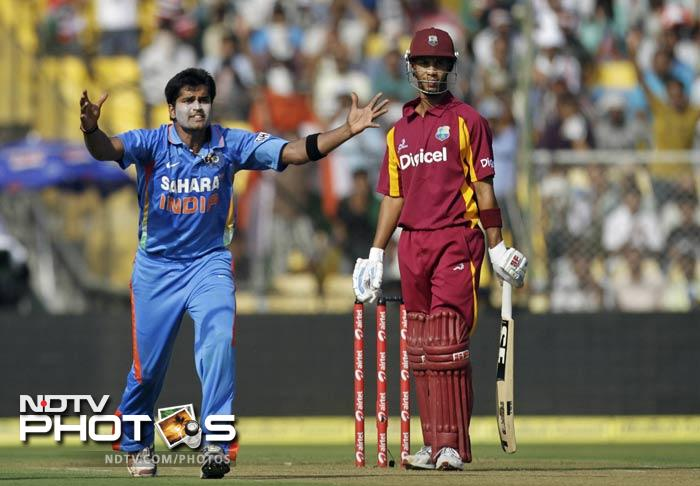 India's stand-in-captain Virender Sehwag won the toss and elected to bowl first. Vinay Kumar drew first blood for the hosts as Parthiv Patel took a stunner behind the wickets to dismiss Lendl Simmons on 1.