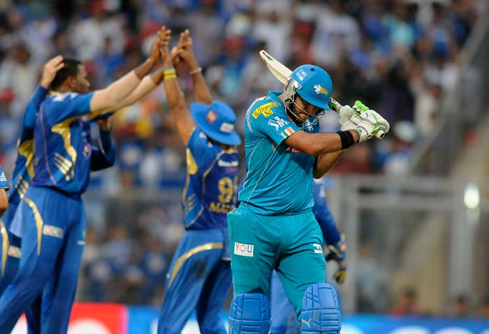 After hammering two sixes and a four in a 16-ball 24-run knock, Yuvraj Singh flat batted a short of length ball from Keiron Pollard, down towards deep mid wicket fieldsman Rishi Dhawan. (BCCI image)