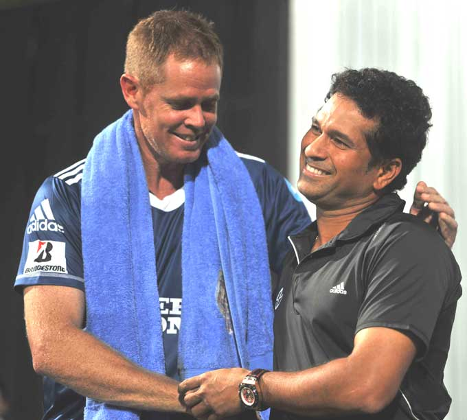 """Pollock though can be seen greeting his old friend here. Rivalries in international cricket aside, the two have had a good rapport since the Protean joined the coaching ranks of the team. (Photo courtesy: <a href=""""http://www.mid-day.com//>Mid-day.com</a>)"""