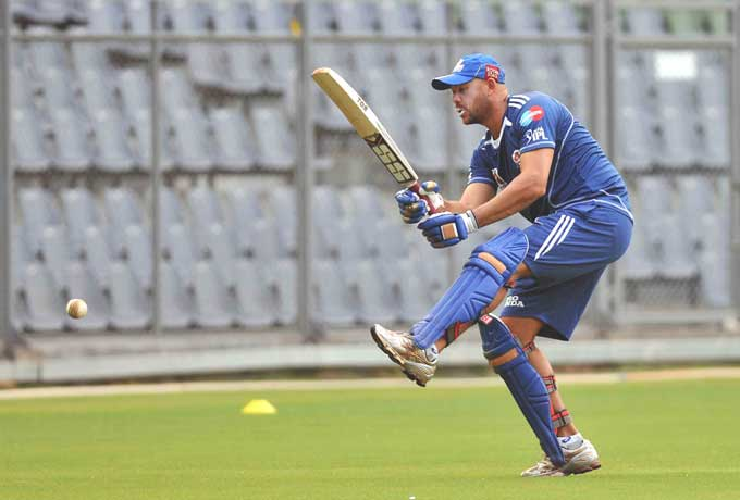 """Andrew Symonds, who has joined the team this year from Chennai Super Kings, has a go with the bat and would hope to clear the grounds once the actual matches begin. (Photo courtesy: <a href=""""http://www.mid-day.com//"""">Mid-day.com</a>)"""