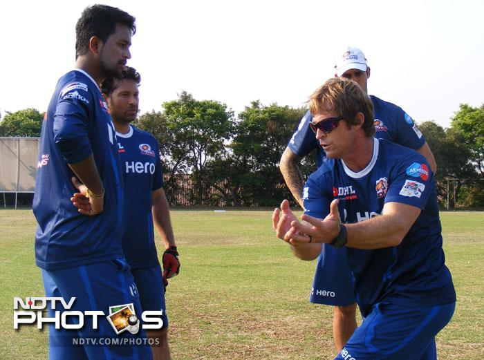 Members of the team pay attention to what fielding coach Jonty Rhodes has to say.