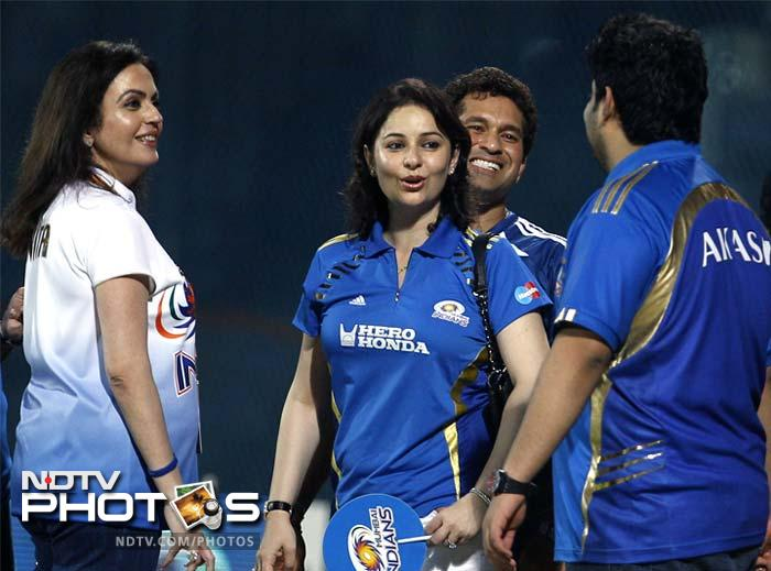 Sachin Tendulkar may have been missing from on-field action but joined the celebrations after Mumbai defended a moderate total of 139 runs. He is seen here with wife Anjali (in blue) and Nita Ambani.
