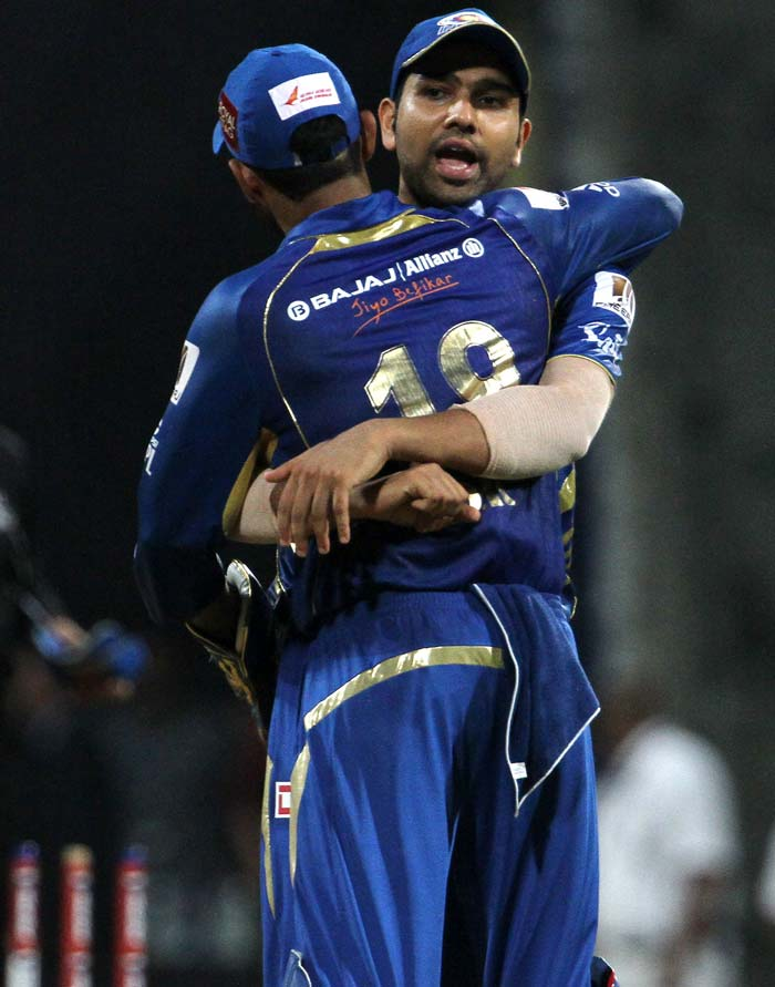 Rohit Sharma, who earlier in the day had a mix up with Dinesh Karthik leading to his run out, hugged the Mumbai wicket-keeper after a successful evening in the field. (BCCI image)