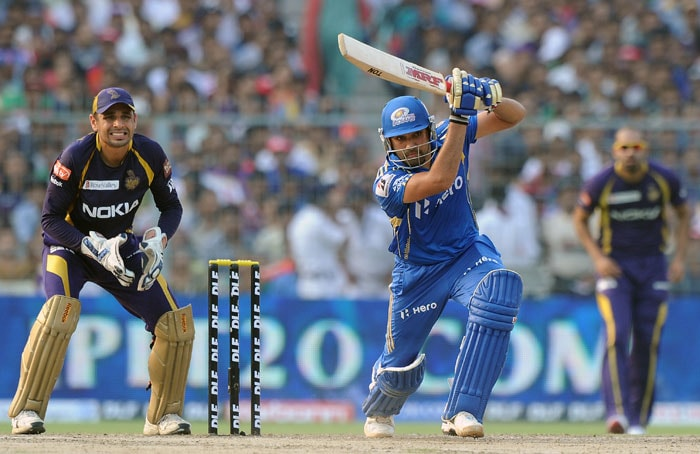 Rohit Sharma joined Gibbs at the crease and looked in fine form straight away. He wrested the initiative away from Kolkata bowlers in a jiffy. He scored his fifty off just 29 balls. (AFP PHOTO/Dibyangshu SARKAR)