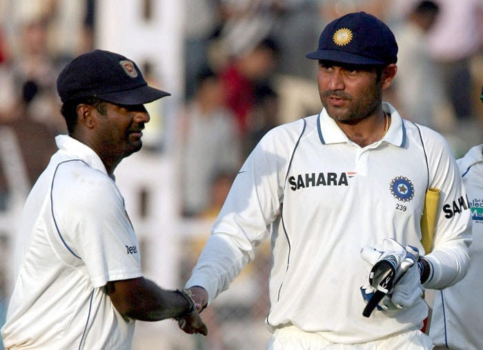 However, when it comes to India, his record tells a different story. He has so far played 21 matches and picked just 97 wickets. In the just concluded series, he picked nine wickets that included Virender Sehwag's dismissal on 293 runs. Sehwag had thrashed Murali all round the Brabourne Stadium and was on the verge of making history when the spin wizard did him in with his magic. (PTI PHOTO)