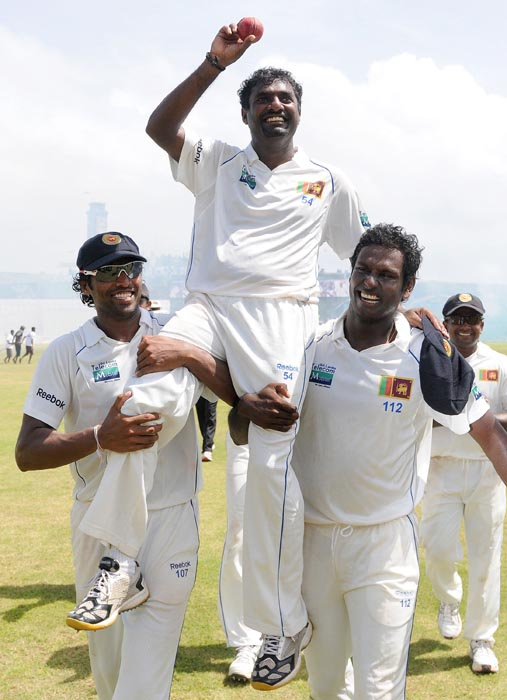 Muttiah had quit Test cricket in July last year. Here he's seen being carried on the shoulders by his teammates in a lap of honour around the pitch after he picked up his record 800th Test wicket in the 1st Test match against India at Galle.<br><br> Muralitharan had announced that he would retire from Test cricket after the end the match and needed 8 wickets to reach the tally.