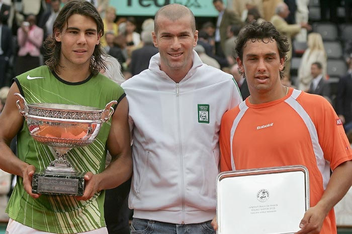 <b>2005: bt Mariano Puerta (ARG) 6-7 (6/8), 6-1, 6-3, 7-5</b><br><br>This is the moment that marks the beginning of a new chapter in tennis history. Nadal, just 19, wins his first French Open on his Paris debut. In the all left-handed final, Nadal downs the unexpected finalist, Puerta. The fourth seeded teenager is the youngest Grand Slam winner since Michael Chang at Roland Garros in 1989, aged 17. Nadal had come into the event as favourite having stormed to victory in the preceding Rome and Monte Carlo Masters. (Seen here in the picture is also football legend Zinedine Zidane)