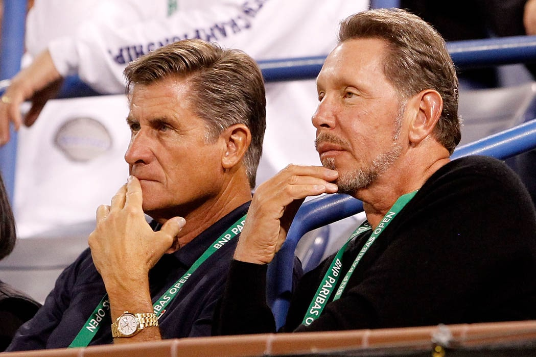 Charlie Pasarell and Larry Ellison watch Rafael Nadal of Spain play Somdev Devvarman of India during the BNP Paribas Open at the Indian Wells Tennis Garden. (AFP Photo)