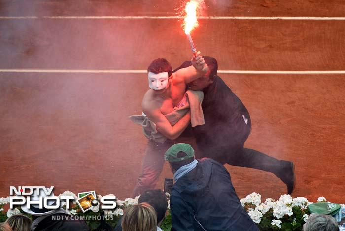 Nadal's push to victory suffered a heart-stopping moment in the second set when a protestor, naked from the waist up, leapt from the stands on court, carrying a flare and protesting France's controversial same sex marriage law.