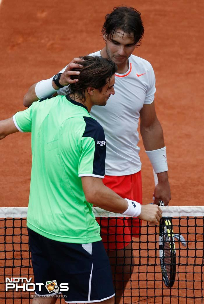 Nadal consoles Ferrer after a crushing straight-sets defeat. It also gave Nadal his 59th win out of 60 matches played in Paris.