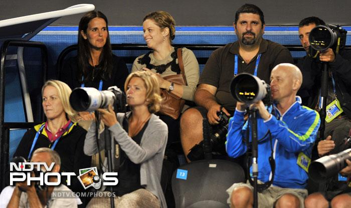 Kim Clijsters (2nd L, last row) was in the stands to watch the two stalwarts fight it out with each other.