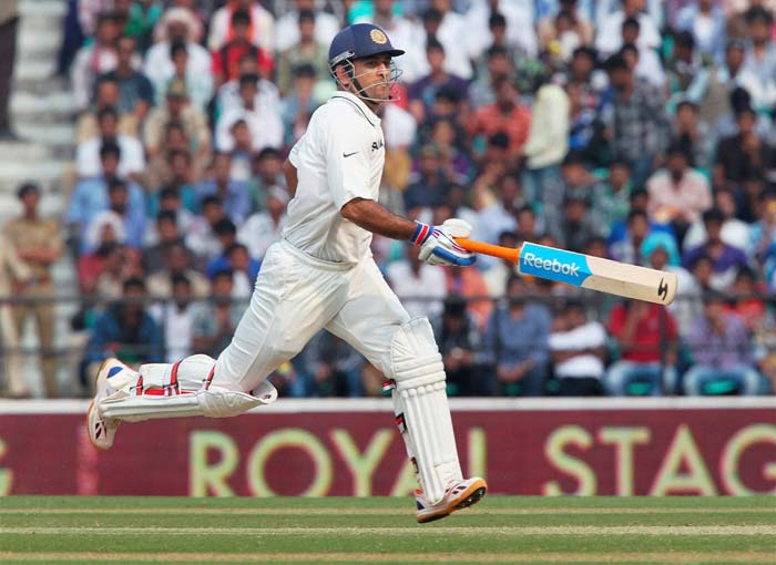 Ravindra Jedeja (12) too fell cheaply while Dhoni (in pic), trying to get a single to complete three-figures, was caught short by the England skipper towards the end of the day's play. The hosts trailed England by 33 and with 2 wickets left, at stumps. (PTI image)