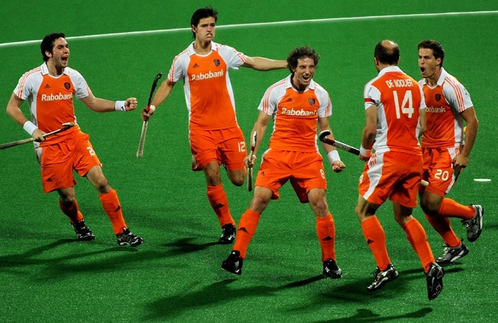 Netherlands hockey player Ronald Brouwer (C) celebrates after scoring a goal against South Korea during their World Cup 2010 match at the Major Dhyan Chand Stadium in New Delhi. (AFP Photo)