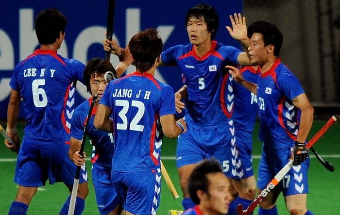 South Korean hockey player Nam Hyun Woo (#5,2R) celebrates after scoring a goal during their World Cup 2010 match at the Major Dhyan Chand Stadium in New Delhi. (AFP Photo)