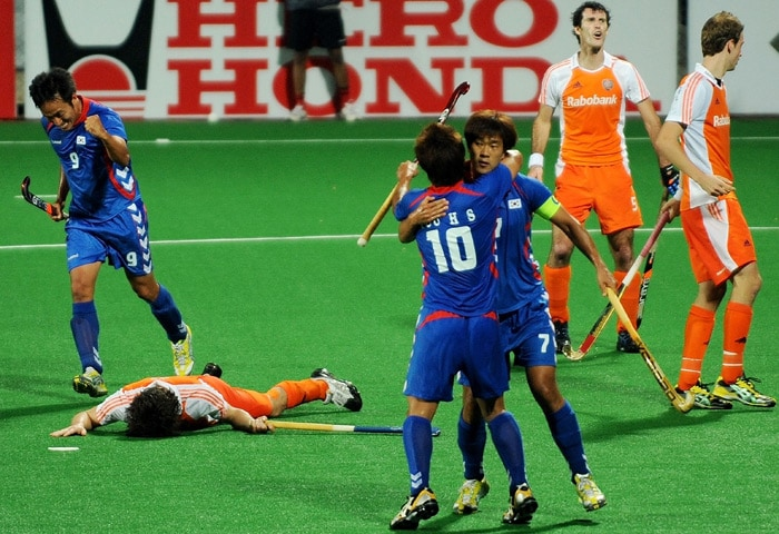 South Korean hockey player Seo Jong Ho(#7,3R) celebrates after scoring a goal during their World Cup 2010 match at the Major Dhyan Chand Stadium in New Delhi. (AFP Photo)