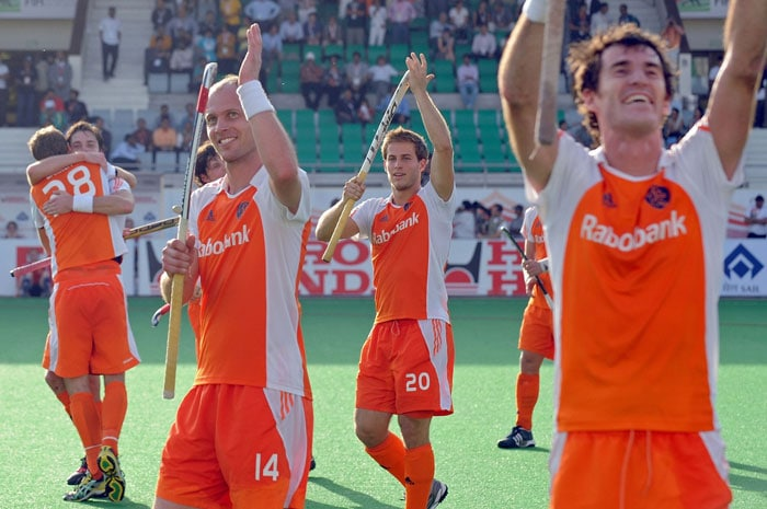 Netherlands Hockey captain Teun de Nooijer (3rd L) acknowledges supporters with teammates after defeating England during their World Cup 2010 classification match for 3rd and 4th place at the Major Dhyan Chand Stadium. Netherlands defeated England by 4-3 to secure the third place. (AFP Photo)