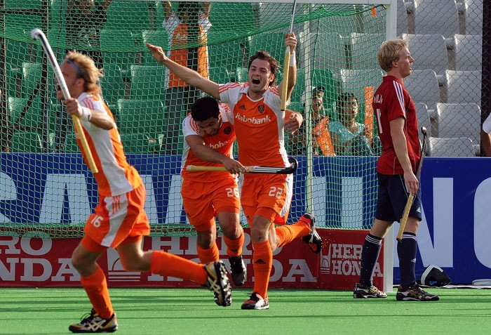 Netherlands Hockey Player Rogier Hofman (2nd R) celebrates a goal against England with Floris Evers (L) and Velatin Verga (2nd L) during their World Cup 2010 classification match for 3rd and 4th place at the Major Dhyan Chand Stadium. Netherlands defeated England by 4-3 to secure third place. (AFP Photo)