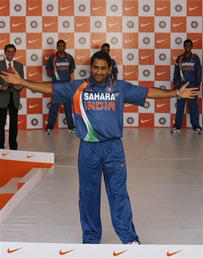 Indian captain Mahendra Singh Dhoni gestures as he displays the new apparel for the Indian one-day international team in Mumbai on Wednesday. (AP Photo)