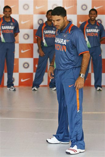 Yuvraj Singh displays the new apparel for the Indian one-day international team in Mumbai on Wednesday. (AP Photo)