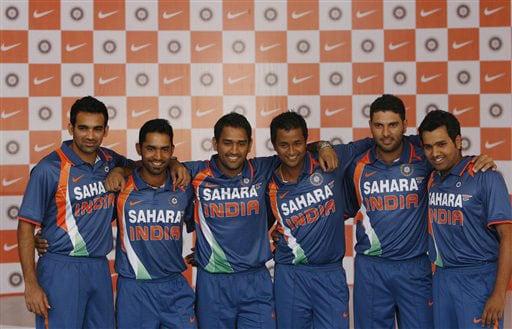 Zaheer Khan, Dinesh Karthik, Mahendra Singh Dhoni, Pragyan Ojha, Yuvraj Singh and Rohit Sharma pose wearing the new apparel for the Indian one-day international team in Mumbai on Wednesday. (AP Photo)