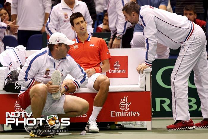 Novak Djokovic twisted his right ankle during Davis Cup quarterfinal tie against Sam Querrey of United States.