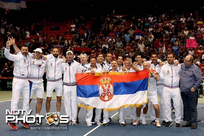 The Serbian team poses for photographers after defeating the US 3-1 during the Davis Cup quarterfinals tie.